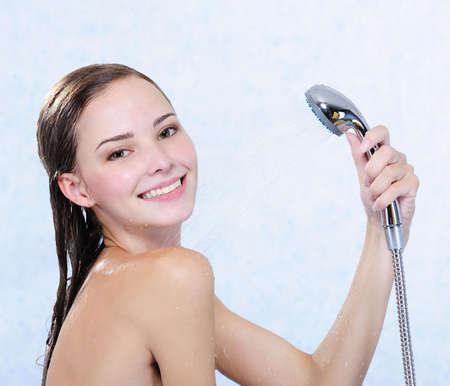 taking shower: Beautiful attractive happy girl taking shower