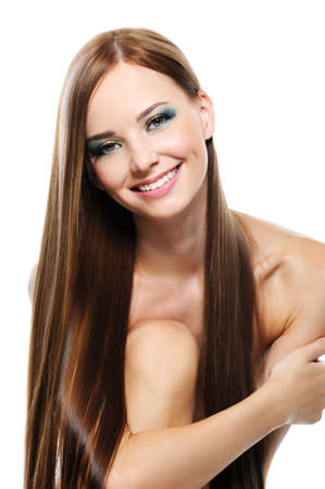 Happy laughing young girl with long beautiful straight hair  photo