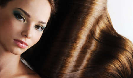 hair design salon: Luxury of beautiful brunette long healthy female hair
