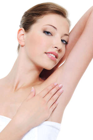 axilla: Portrait of pretty woman stroking her clean fresh armpit Stock Photo
