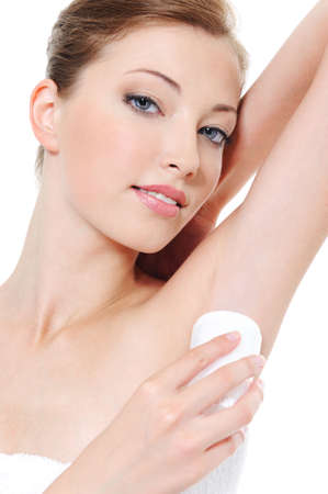 adult armpit: Applying cream deodorant on the armpit by young woman - close-up  Stock Photo