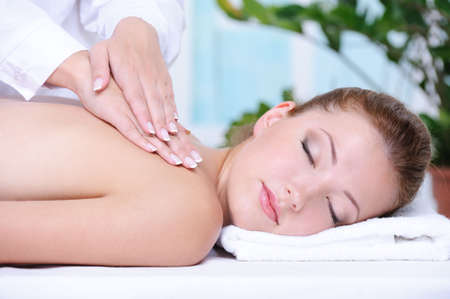 Portrait of girl getting back massage and relaxation in the spa salon Stock Photo - 5248863
