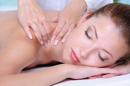 Relaxation in the spa salon for the pretty beautiful woman- close-up face photo