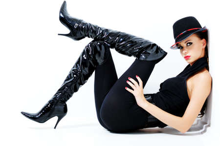Glamour fashionable gorgeous woman with black style - indoors  photo