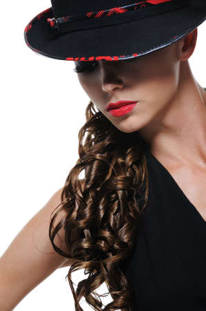 Glamour portrait of cute elegant young girl with black hat photo