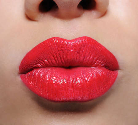 red lips: Macro shot of beautiful  glamour bright red female lips  �������