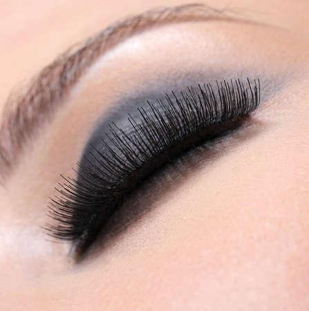 thick: Human eye with volume luxuriant eyelashes - macro shot