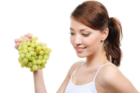 beautiful woman with bunch of grapes - isolated on white background photo