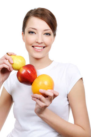 beauty of young laughing woman holding some fruits  photo