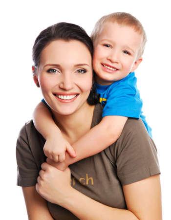 shoulder: young little son embracing his pretty young mother Stock Photo