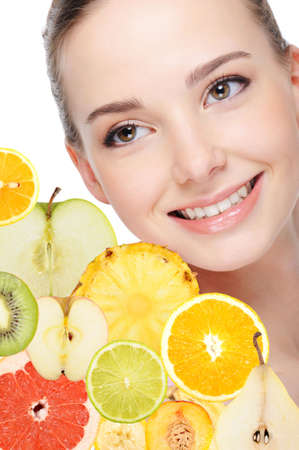 portrait of adult pretty woman with fruits photo