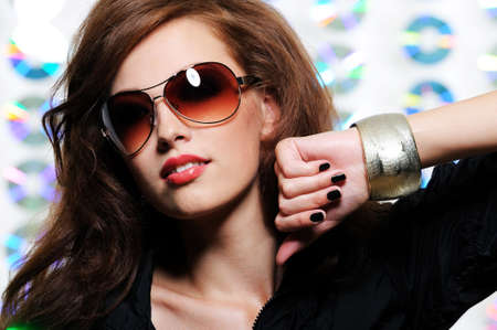 elegancy: Portrait of fashion glamour beautiful brunette girl in the modern sunglasses Stock Photo