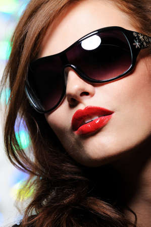 Portrait of beautiful pretty female face with glamour fashion sunglasses on it photo