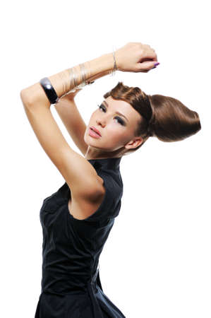 feminity: beautiful brunette young woman with fashion creative hairstyle