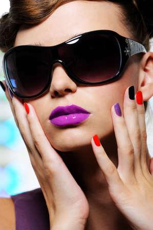 fashionable sunglasses: beautiful female face with stylish sunglasses - close-up portrait Stock Photo