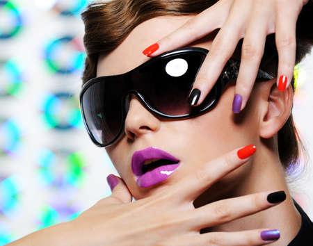 Woman with multicolored manicure and fashion stylish sunglasses Stock Photo - 5501185