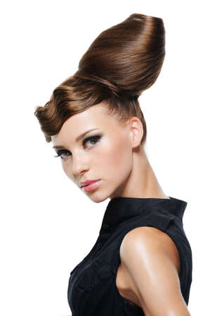 artistic woman: portrait of beautiful young woman with creative fashion hairstyle