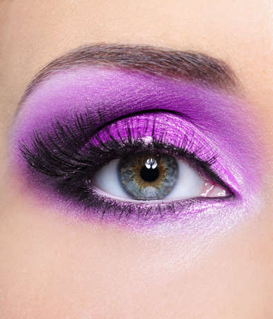 Purple shine make-up of woman eye - mfront view photo