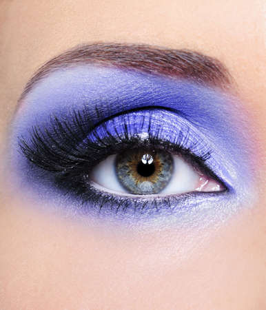 long eyelashes: Make-up of woman eye withlight blue eyeshadows