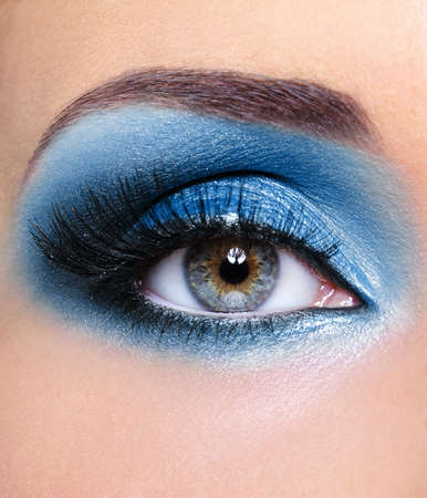 Blue glamour make-up of woman eye - macro shot photo