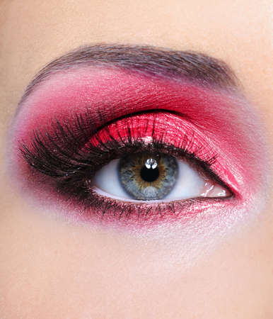 Make-up of woman eye with red bright eyeshadow - macro shot photo