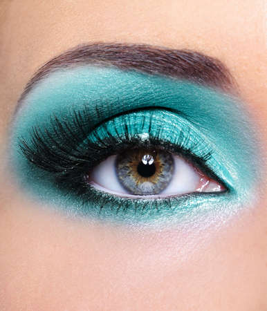 Turquoise glamour make-up of woman eye - macro shot photo
