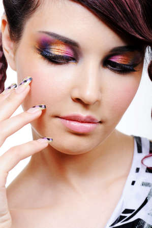 Multicolored eyeshadow for beautiful young pretty woman photo