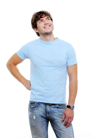 casuals: Beautiful handsome guy in casuals looking up - white background