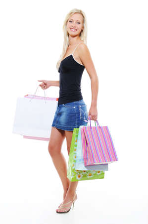 Full-lenghth portrait of a beautiful woman with purchases over whitebackground Stock Photo - 5594185