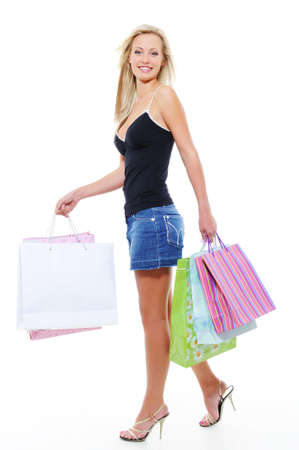 Walking young beautiful woman after shopping - white background Stock Photo - 5594135