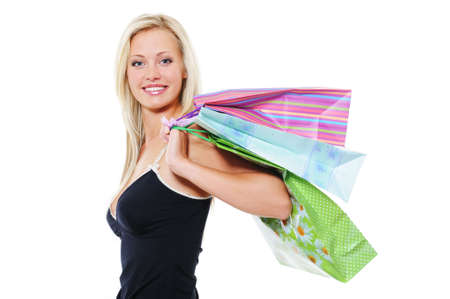 Beauty smiling blond woman holding shopping bags over white background photo