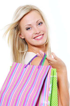 Close-up portrait of smiling blonde  woman with shopping bags over white background Stock Photo - 5594149