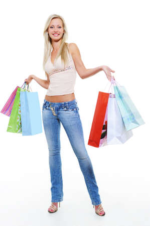 Full-length portrait of a happy woman after shopping with purchases Stock Photo - 5594157