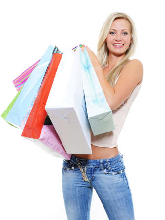 Beautiful pretty woman with many purchases over white background Stock Photo - 5594163