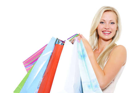 Portrait of an attractive laughing blond woman present purchases after shopping photo