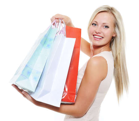 Portrait of an attractive fresh woman present purchases - copy space photo