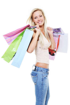 Beautiful smiling happy woman holding shopping bags over white background Stock Photo - 5594178