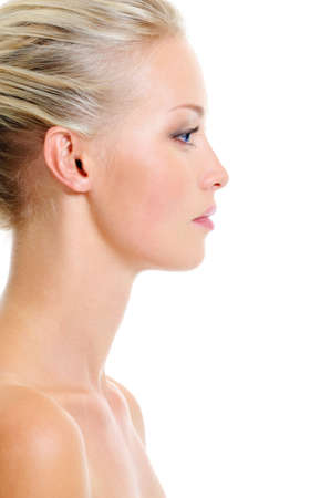 Profile portrait of healthy caucasian blonde woman over white background  Stock Photo
