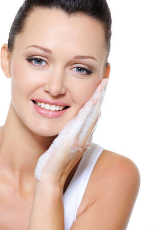 woman washing face: Beauty smiling woman cleaning face with cosmetic soap