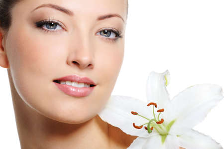 Fresh clear healthy skin on the face of beautiful woman over white background Stock Photo - 5620113
