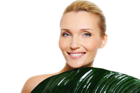 Happy young beautiful woman with clean health skin  and fresh leaf covering her body Stock Photo - 5627373