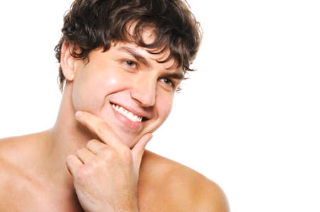 Portrait of handsome young man with clean-shaven face and happy smile photo