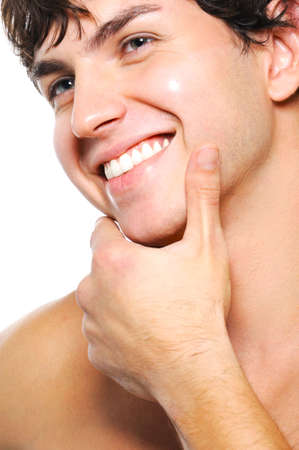 chin: Close-up portrait of cleanshaven male face with a toothy smile Stock Photo