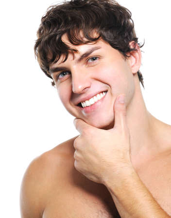 pleasant: Pleasant face of a happy young man with health  clean skin