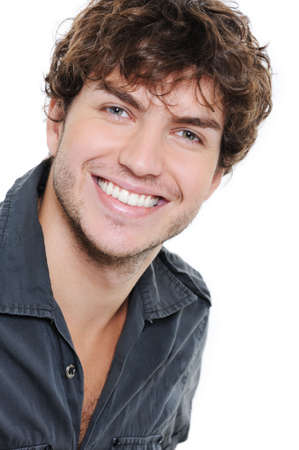smiling teeth: Happy smile and healthy teeth on the face of young man over white