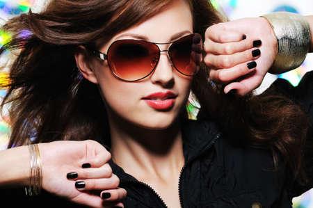 feminity: Glamour stylish beautiful  woman with fashion sunglasses and black manicure