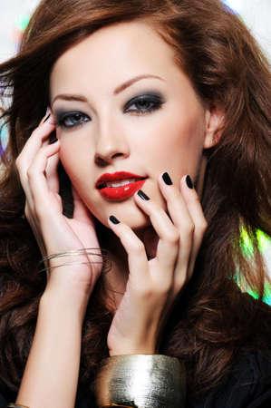 feminity: Bright stylish make-up on the beautiful pretty female face