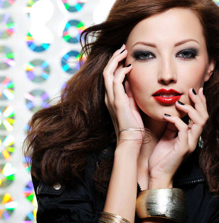 Beauty woman with bright fashion eye make-up and red lips photo