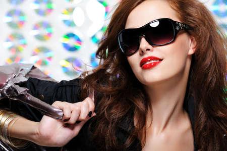 glamour beautiful young woman with fashion sunglasses and handbag Stock Photo - 5645590