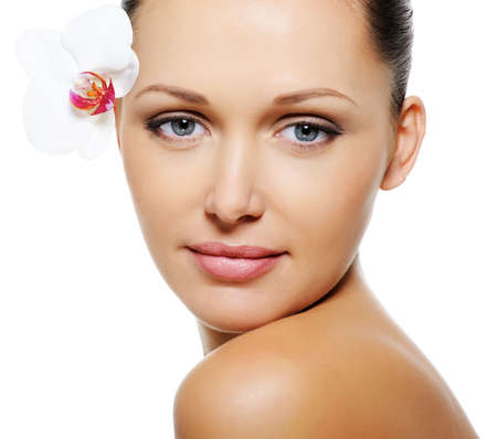Beautiful pretty woman with  clear skin and flower near her eyes Stock Photo - 5654711